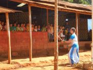 Circus performer entertaining children at Thai refugee camp