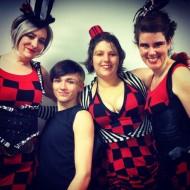 Stiltwalkers in vibrant costumes entertaining in Victoria