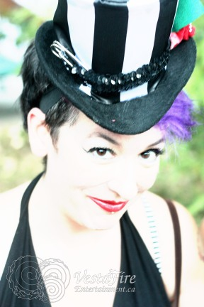 woman in black-and-white striped tophat