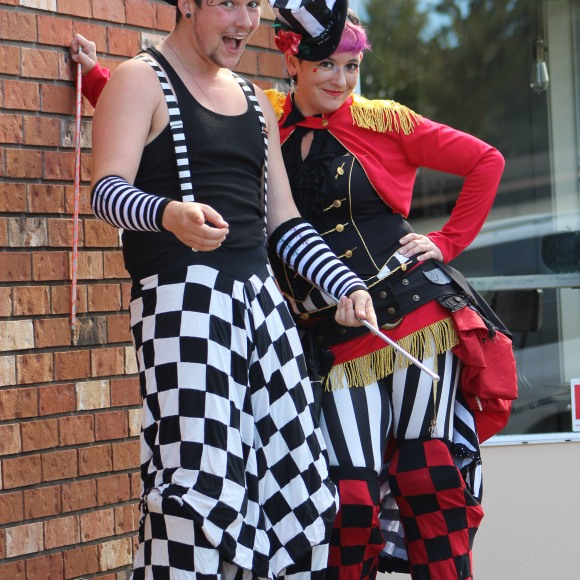 Carnival stiltwalkers roving circus show in Victoria BC
