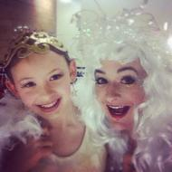 Entertainers in white Christmas angel costumes in Victoria