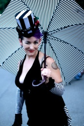 Circus performer with striped umbrella on Gabriola Island