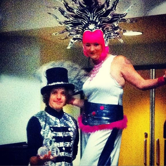Roving circus stiltwalkers at holiday party in Vancouver