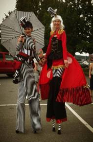 Entertainers on stilts in carnival costume for circus show in Nanaimo