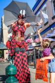 Stilter in red checker costume gets a high-five