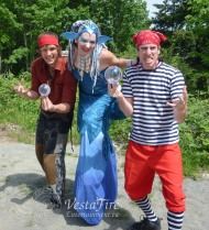 Mermaid stilter and pirates at wooden boat festival in BC