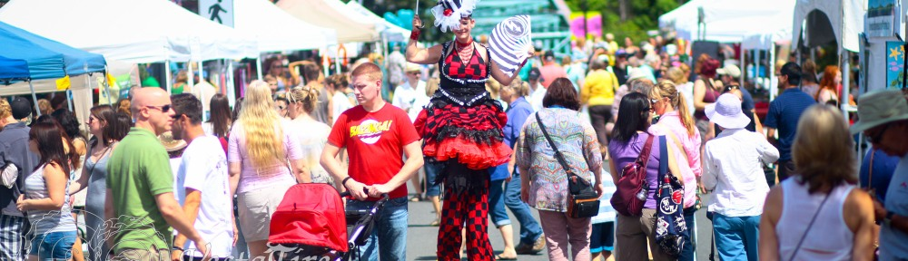 Carnival stilt performer at Comox art show