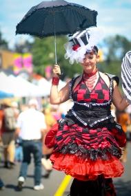 Entertaining stiltwalker at outdoor festival in Vancouver