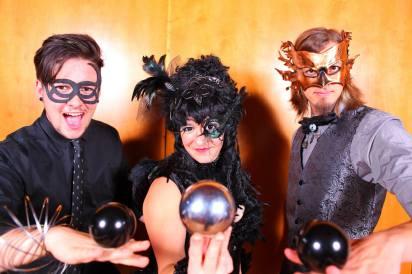 Vesta Troupe Contact Juggling in mardi-gras costumes