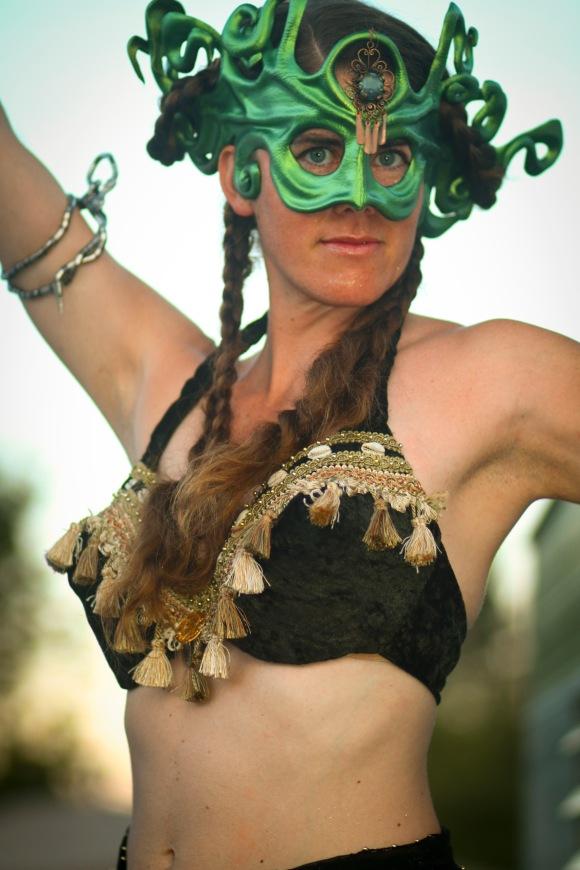 Mystical stiltwalker in outdoor circus show in Victoria