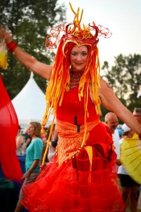 Vibrant circus stilter at music festival in Nanaimo