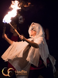 Circus entertainer juggles fire at Halloween show in Vancouver