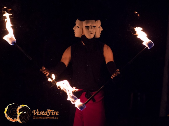 Circus performer juggling fire on Vancouver Island