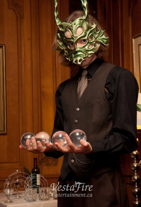 Contact Juggling circus performer in Dragon mask