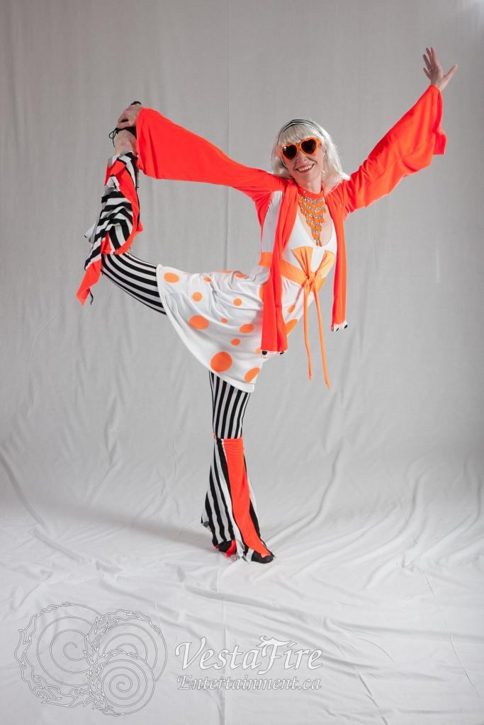 Circus performer in bright orange costume