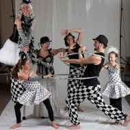 Circus troupe playing backstage during a photo shoot