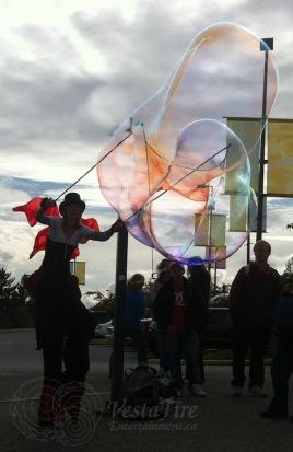 stilter Melissa making large colourful bubbles