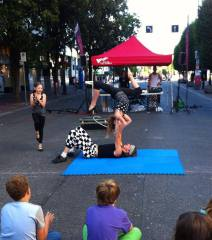 Street busking show with circus acrobats
